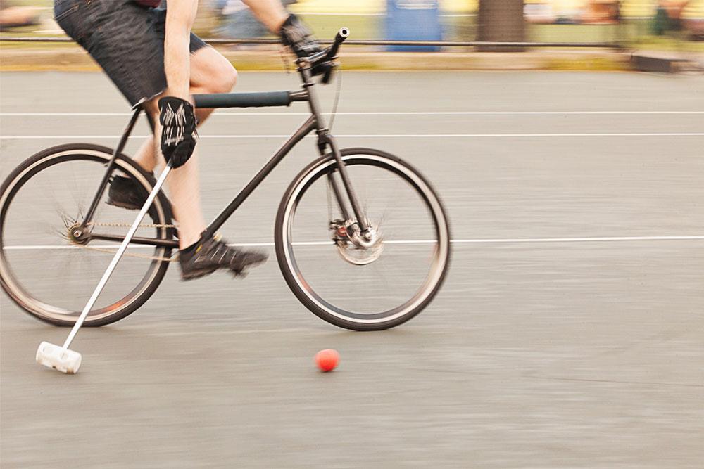 Hitting polo ball on a bike
