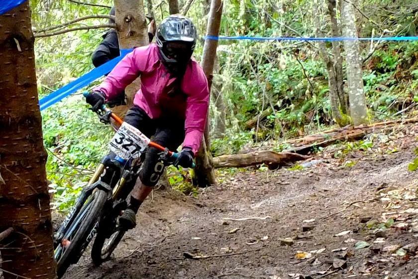 Woman racing a mountain bike