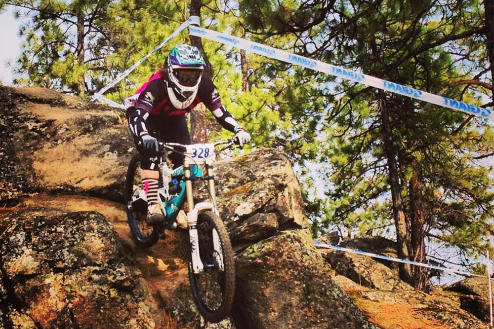 Woman racing mountain bike